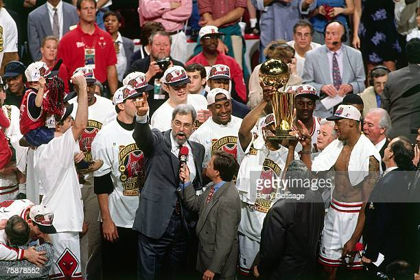 Chicago Bulls head coach Phil Jackson celebrates winning the 1996 NBA Championship on June 16 1996 at the United Center in Chicago Illinois NOTE TO...
