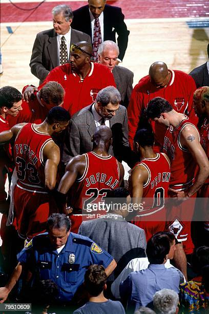 Chicago Bulls head coach Phil Jackson instructs his team in Game Four of the 1996 NBA Finals against the Seattle SuperSonics at Key Arena on June 12...