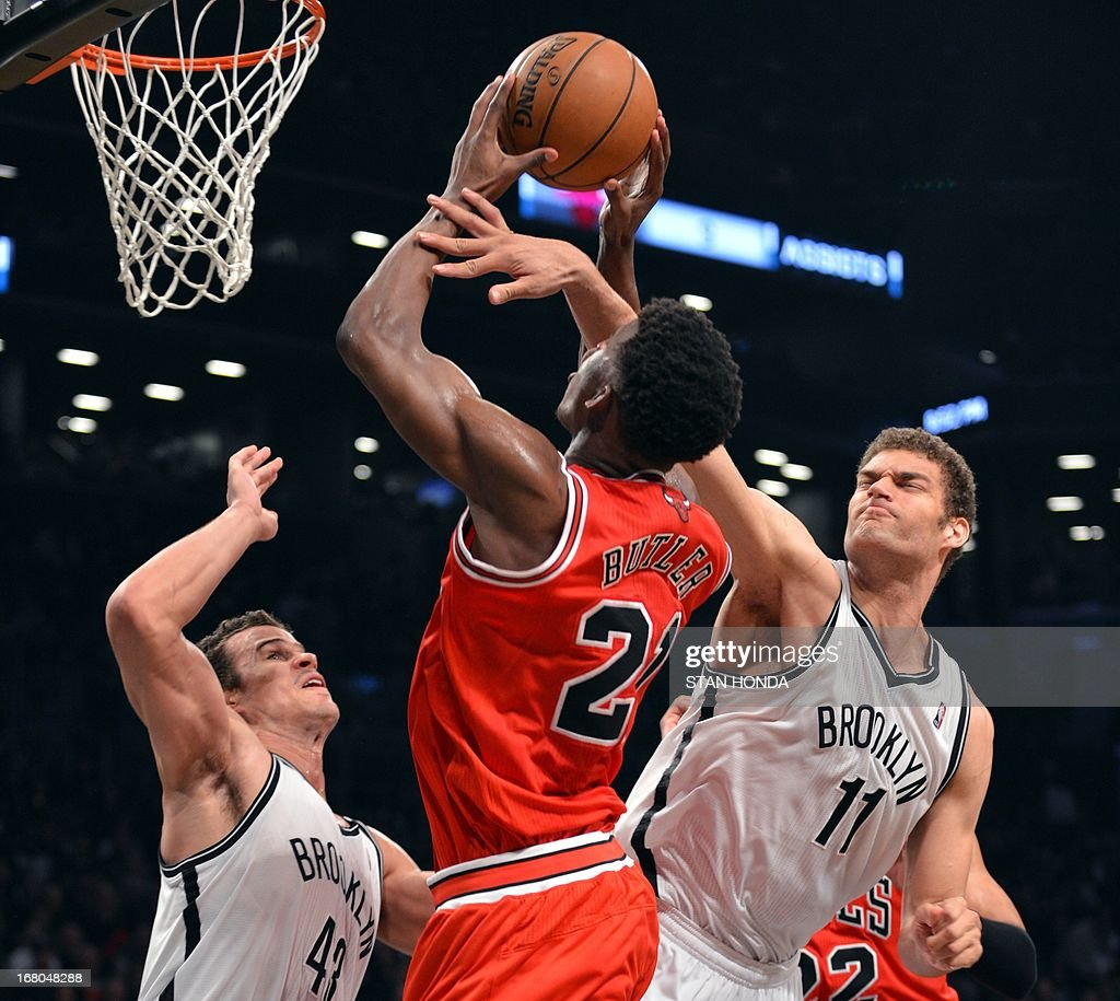 Chicago Bulls Jimmy Butler drives to the net against Brooklyn Nets Kris Humphries (L) and Brook Lopez during Game 7 of the Eastern Conference quarterfinals at the Barclays Center on May 4 , 2013 in the Brooklyn borough of New York City.