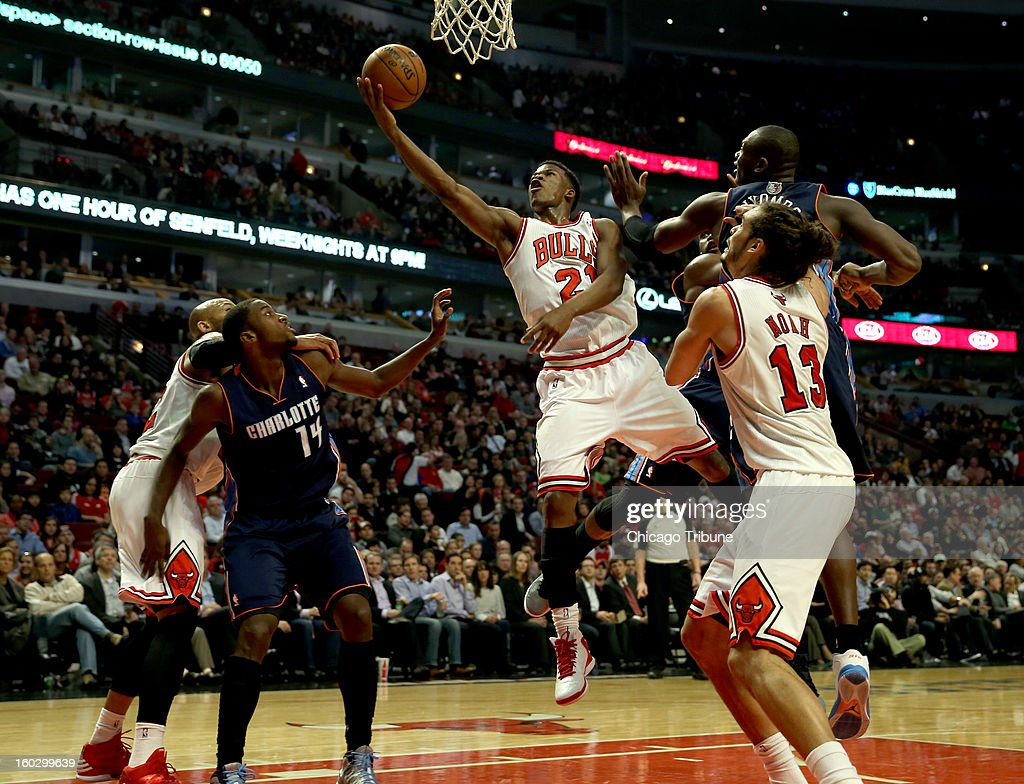 Chicago Bulls' Jimmy Butler scores against the Charlotte Bobcats in 2nd-quarter action at the United Center in Chicago, Illinois on Monday, January 28, 2013.
