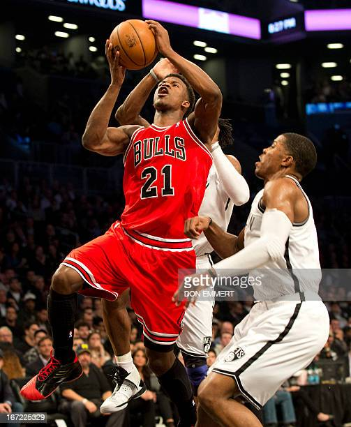 Chicago Bulls Jimmy Butler takes a shot against Brooklyn Nets Joe Johnson during game two of their first round NBA playoff game April 22 2013 at the...