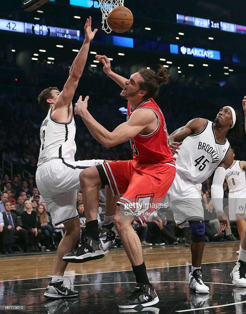 Chicago Bulls' Joakim Noah has his shot blocked by Brooklyn Nets' Kris Humphries during 2nd-quarter action in Game 5 of the NBA Eastern Conference playoffs at the Barclays Center in Brooklyn, New York, Monday, April 29, 2013.