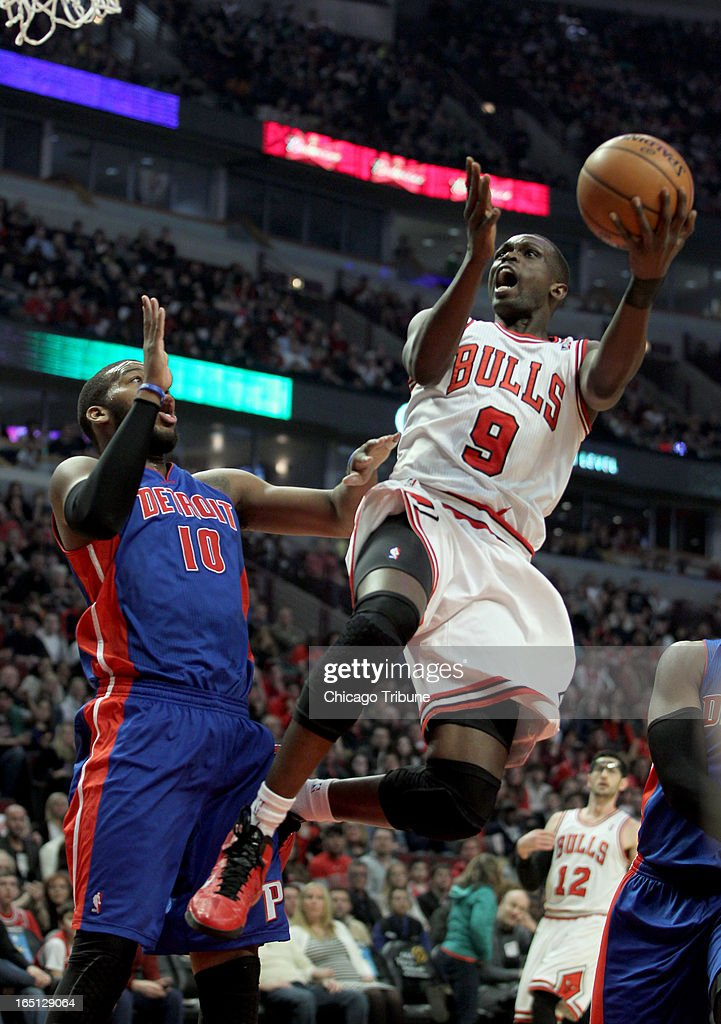 Chicago Bulls' Luol Deng drives on Detroit Pistons' Greg Monroe in the 1st quarter at the United Center on Sunday, March 31, 2013, in Chicago, Illinois.