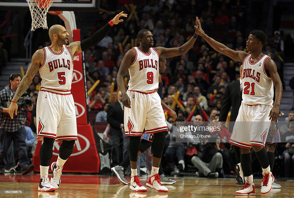 Chicago Bulls' Luol Deng, Jimmy Butler and Carlos Boozer celebrate Deng's 3-pointer in the 2nd quarter against the Charlotte Bobcats at the United Center in Chicago, Illinois on Monday, January 28, 2013.