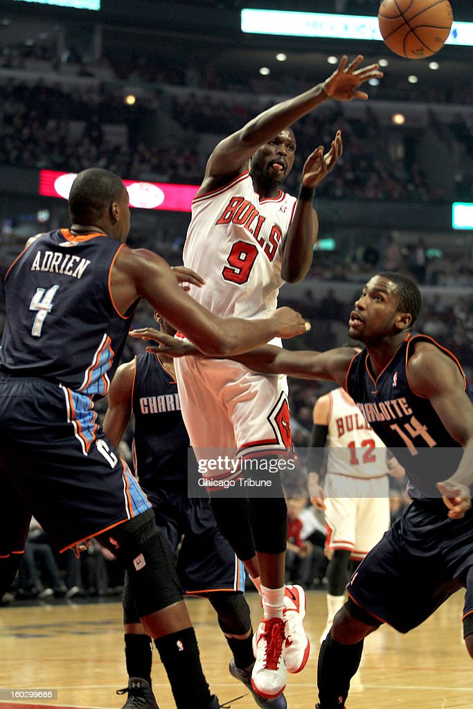 Chicago Bulls' Luol Deng passes over Charlotte Bobcats' Michael Kidd- Gilchrist (14) during 1st-quarter action at the United Center in Chicago, Illinois on Monday, January 28, 2013.