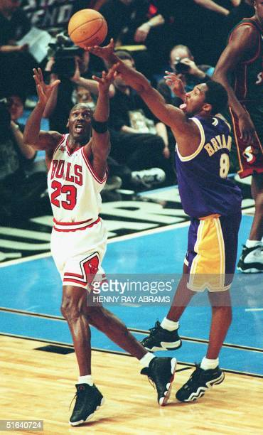 Chicago Bulls' Michael Jordan and Los Angeles Lakers' Kobe Bryant chase a loose ball in the first quarter of the 1998 NBA AllStar Game at Madison...