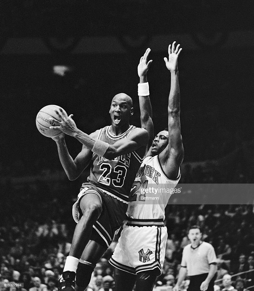 Chicago Bulls' Michael Jordan drives to the basket on the New York Knicks' Gerald Wilkins before passing the ball off in the fourth quarter of their...