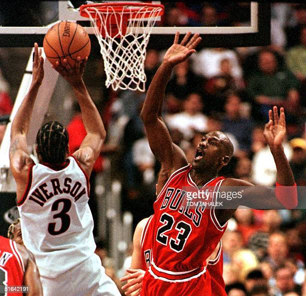 Chicago Bulls Michael Jordan reacts as Philadelphia 76ers Allen Iverson goes up to the basket for two points in the game 15 January in Philadelphia...