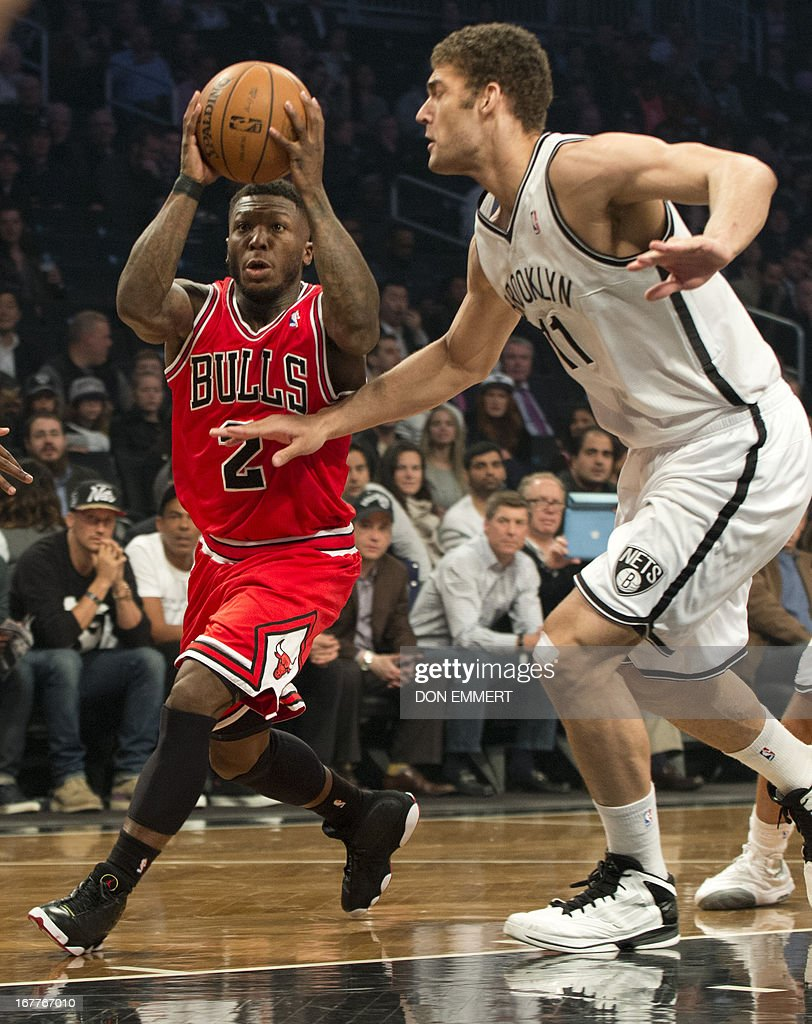 Chicago Bulls Nate Robinson (2) drives against Brooklyn Nets Brook Lopez (11) during game five of their first round NBA playoff game April 29, 2013 at the Barclay Center in New York. AFP PHOTO/Don Emmert