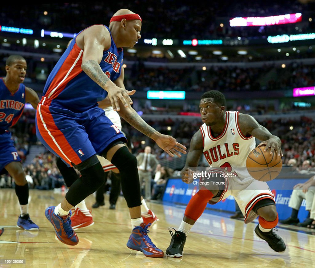 Chicago Bulls' Nate Robinson is guarded by Detroit Pistons' Charlie Villanueva in the 2nd quarter at the United Center on Sunday, March 31, 2013, in Chicago, Illinois.