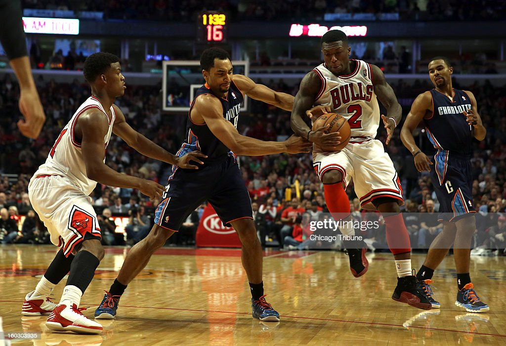 Chicago Bulls' Nate Robinson steals the ball from Charlotte Bobcats' Gerald Henderson in 3rd quarter action at the United Center in Chicago, Illinois on Monday, January 28, 2013. Bulls win, 93-85.