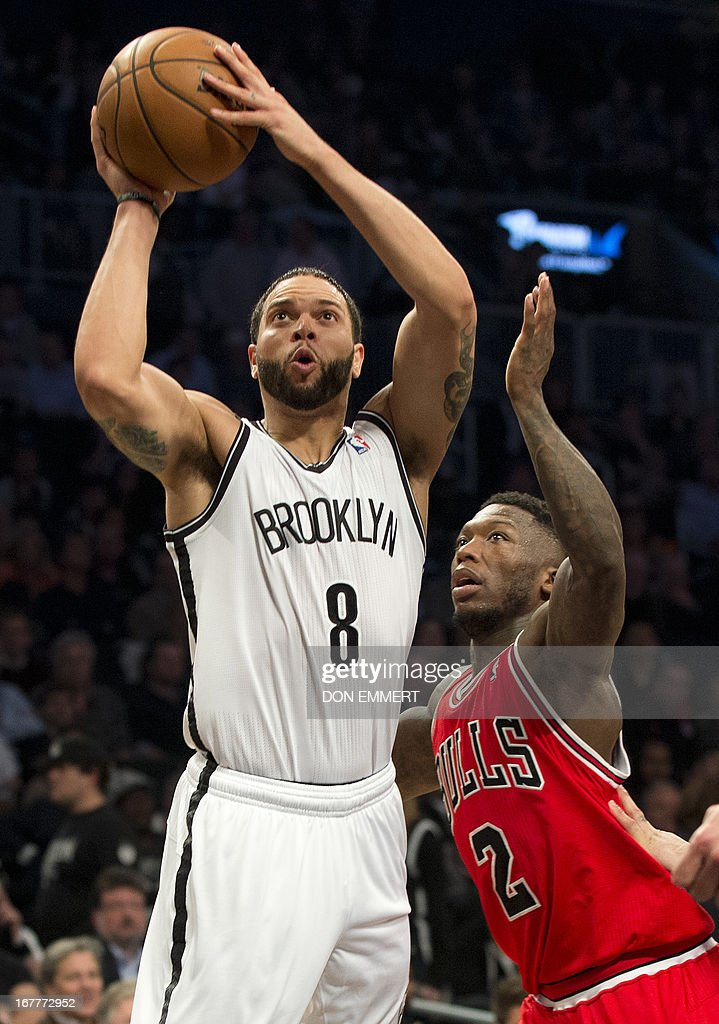 Chicago Bulls Nate Robinson (2) tries to stop a shot by Brooklyn Nets Deron Williams (8) during game five of their first round NBA playoff game April 29, 2013 at the Barclay Center in New York. AFP PHOTO/Don Emmert