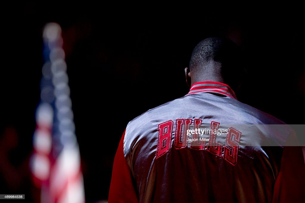 Chicago Bulls player bows his head during the national anthem prior to the game against the Cleveland Cavaliers at Quicken Loans Arena on April 5...
