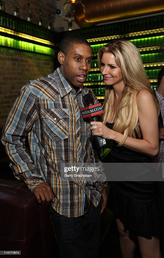 Chicago Bulls player CJ Watson and Maxim Hometown Hottie Winner April Rose attends the Marisa Miller and Maxim Host Legendary Birthday Party for Captain Morgan at Public House on May 13, 2011 in Chicago, Illinois.