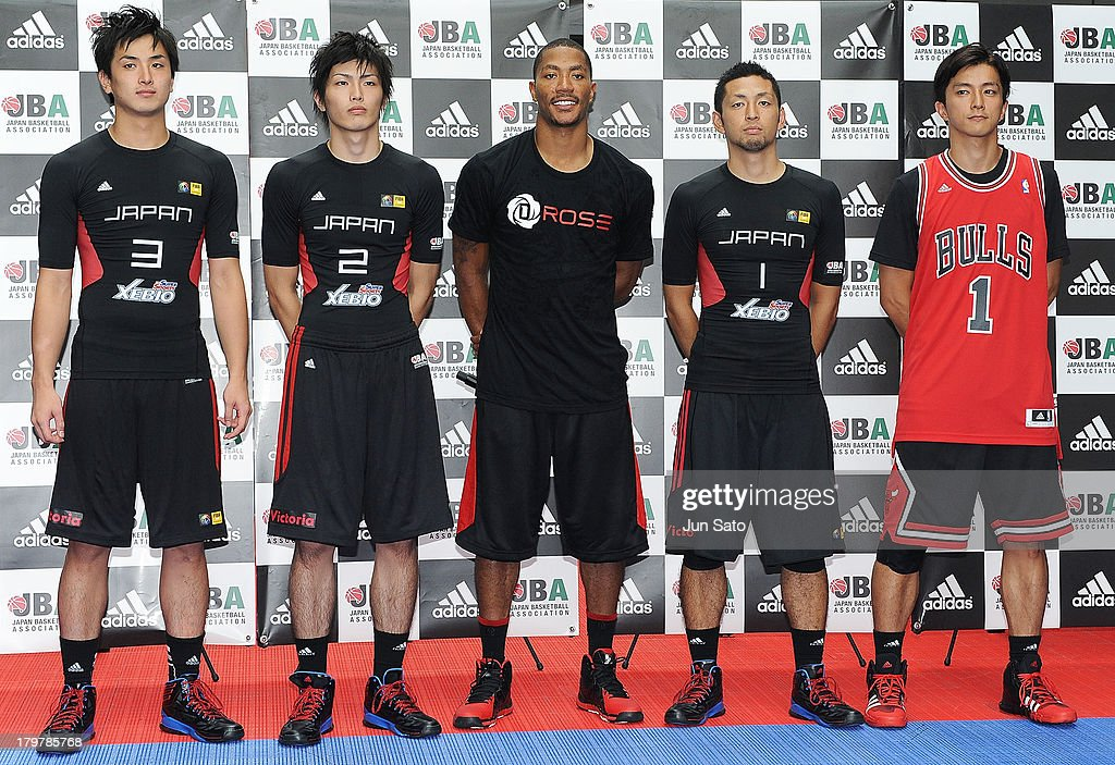 Chicago Bulls point guard <a gi-track='captionPersonalityLinkClicked' href=/galleries/search?phrase=Derrick+Rose&family=editorial&specificpeople=4212732 ng-click='$event.stopPropagation()'>Derrick Rose</a> (C) attends Adidas 'All In For D Rose' at Roppongi Hills on September 7, 2013 in Tokyo, Japan.