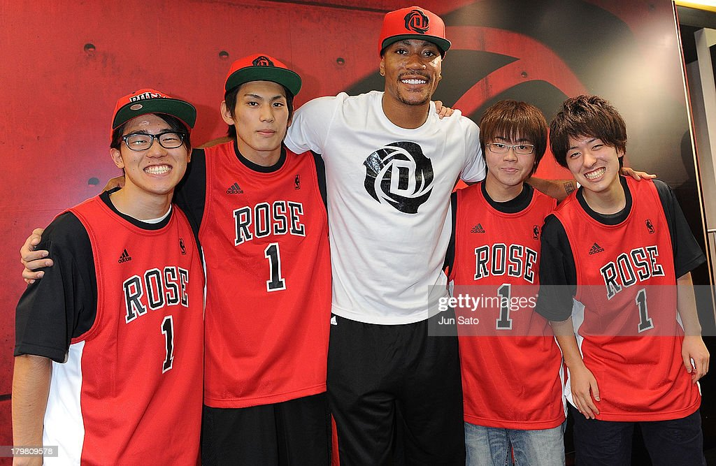 Chicago Bulls point guard <a gi-track='captionPersonalityLinkClicked' href=/galleries/search?phrase=Derrick+Rose&family=editorial&specificpeople=4212732 ng-click='$event.stopPropagation()'>Derrick Rose</a> poses with fans as he visits Adidas Performance Center on September 7, 2013 in Tokyo, Japan.