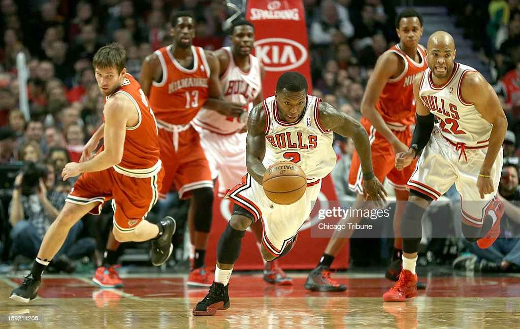 Chicago Bulls point guard Nate Robinson (2) starts a fast break after stealing the ball from Milwaukee Bucks point guard Beno Udrih (19) in the first quarter at the United Center on Wednesday, January 9, 2013, in Chicago, Illinois.