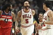 Chicago Bulls power forward Carlos Boozer reacts after a basket by teammate Chicago Bulls point guard DJ Augustin against the Washington Wizards...