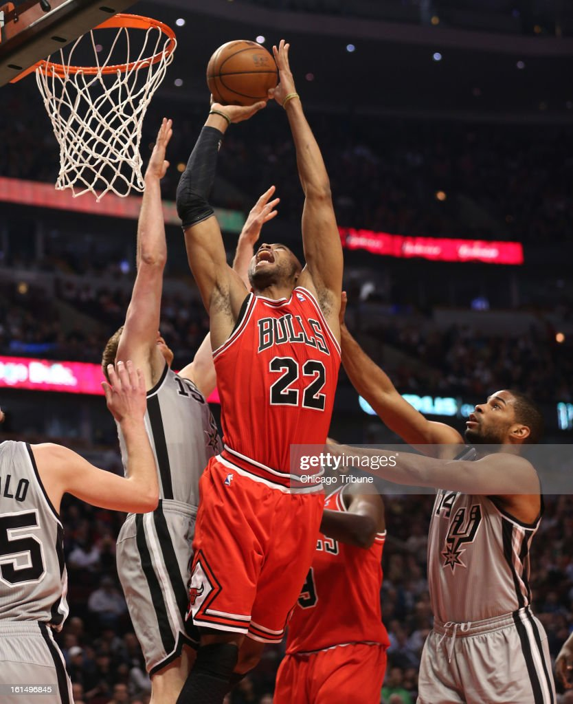 Chicago Bulls power forward Taj Gibson (22) goes up against San Antonio Spurs power forward Matt Bonner (15) during the first half at the United Center in Chicago, Illinois, Monday, February 11, 2013.