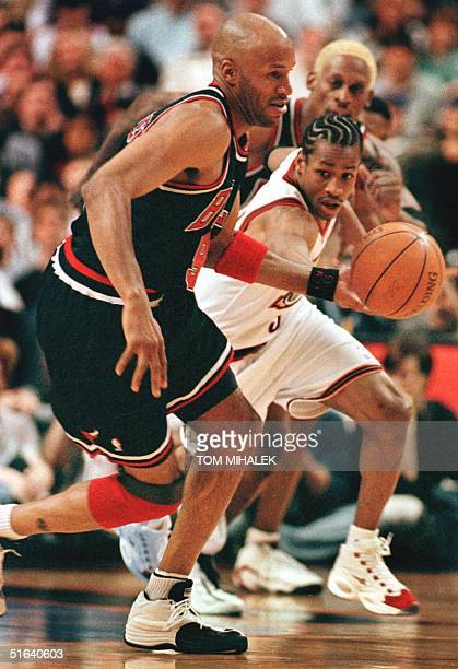 Chicago Bulls Ron Harper heads downcourt after stripping the ball from the Philadelphia 76ers Allen Iverson 17 April in Philadelphia The Bulls won...