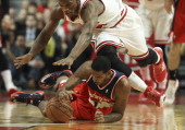 Chicago Bulls shooting guard Jimmy Butler dives over Washington Wizards small forward Trevor Ariza for a loose ball during the first half at the...