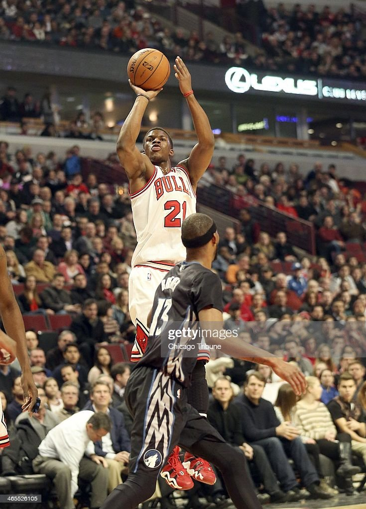 Chicago Bulls shooting guard Jimmy Butler (21) shoots over Minnesota Timberwolves small forward Corey Brewer (13) during the first half of their game at the United Center in Chicago on Monday, Jan., 27, 2014.