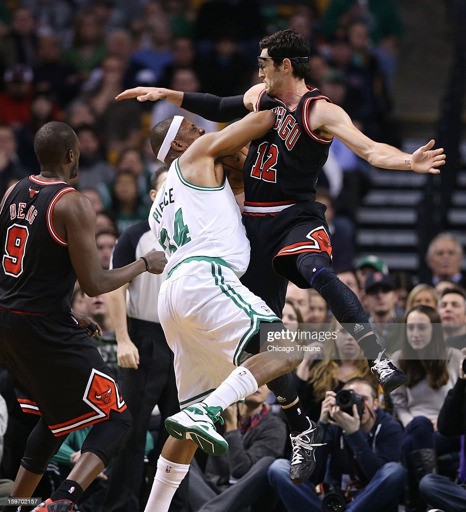 Chicago Bulls shooting guard Kirk Hinrich (12) fouls Boston Celtics small forward Paul Pierce (34) in the first half at TD Garden in Boston, Massachusetts, Friday, January 18, 2013.