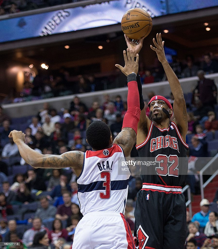 Chicago Bulls shooting guard Richard Hamilton (32) shoots over Washington Wizards shooting guard Bradley Beal (3) during the first half of their game played at the Verizon Center in Washington, D.C., Saturday, January 26, 2013.