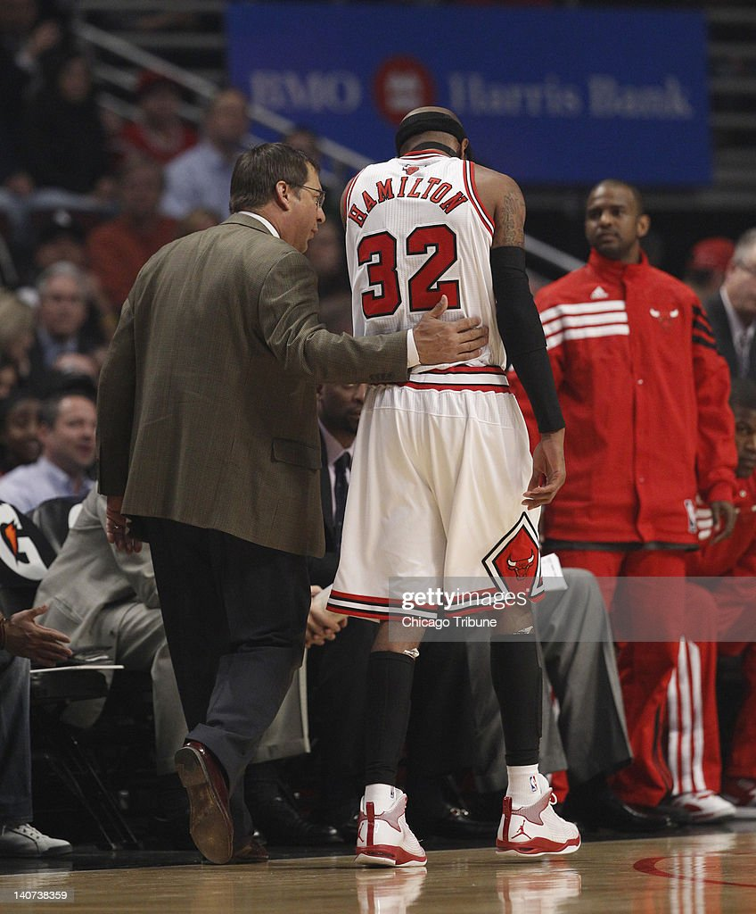 Chicago Bulls shooting guard Richard Hamilton (32) walks off the court with the help of head athletic trainer Fred Tedeschi during the first quarter of their game against the Indiana Pacers at the United Center in Chicago, Illinois, on Monday, March 5, 2012.
