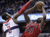 Chicago Bulls small forward Jimmy Butler puts up a shot against Washington Wizards point guard John Wall in the first half at the Verizon Center in...