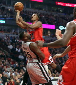 Chicago Bulls small forward Jimmy Butler runs into San Antonio Spurs center DeJuan Blair during the first half at the United Center in Chicago...