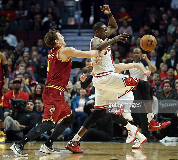 Chicago Bulls small forward Luol Deng intercepts a pass intended for Cleveland Cavaliers small forward Luke Walton in the second quarter at the...