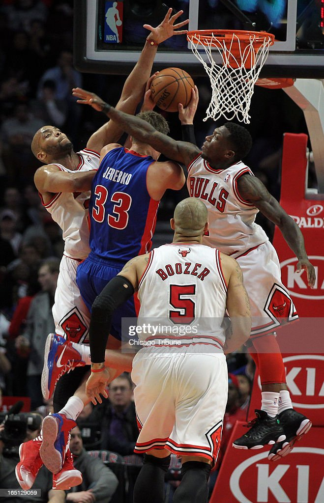 Chicago Bulls' Taj Gibson and Nate Robinson double-team Detroit Pistons' Jonas Jerebko in 2nd-quarter action at the United Center on Sunday, March 31, 2013, in Chicago, Illinois.