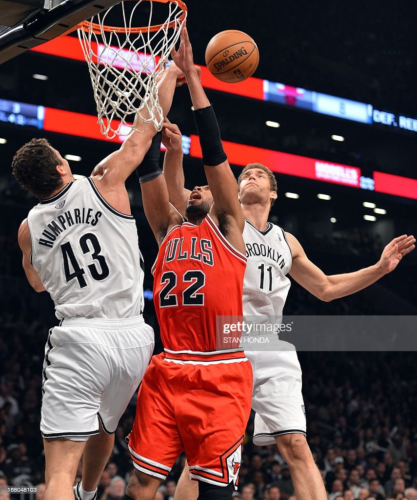 Chicago Bulls Taj Gibson drives to the net against Brooklyn Nets Kris Humphries (L) and Brook Lopez during Game 7 of the Eastern Conference quarterfinals at the Barclays Center on May 4 , 2013 in the Brooklyn borough of New York City.