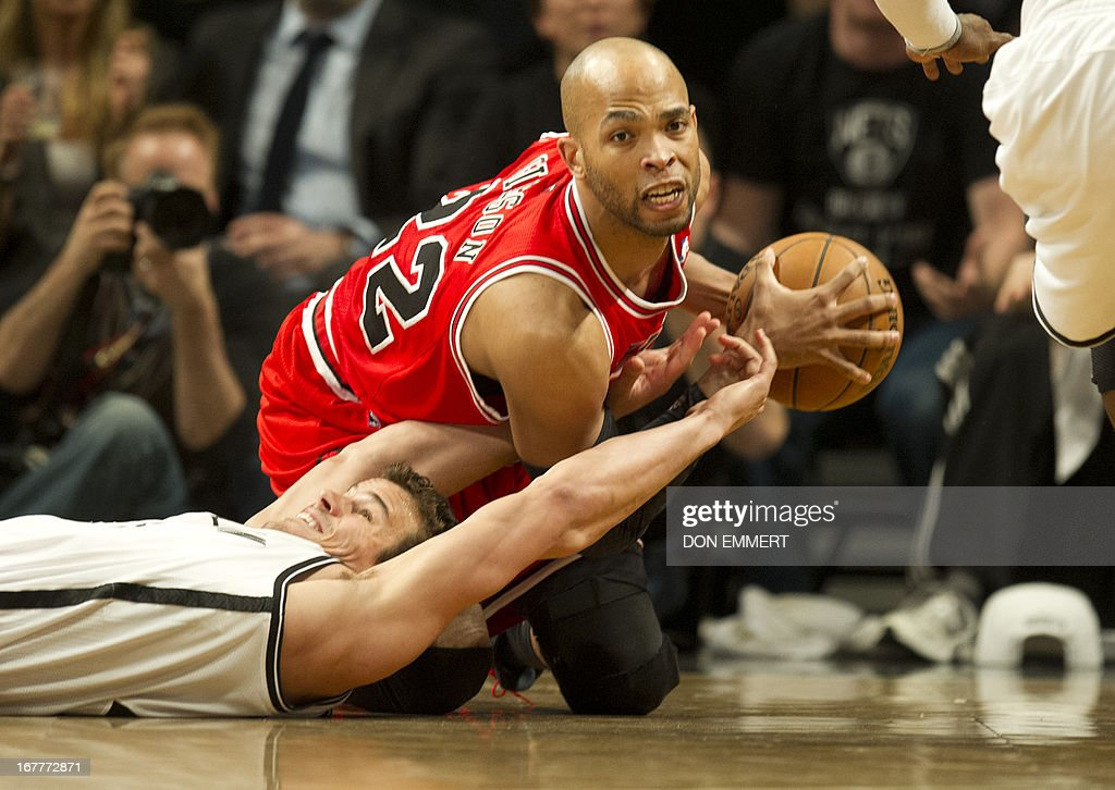Chicago Bulls Taj Gibson (TOPS) fights for the ball with Brooklyn Nets Kris Humphries (43) during game five of their first round NBA playoff game April 29, 2013 at the Barclay Center in New York. AFP PHOTO/Don Emmert