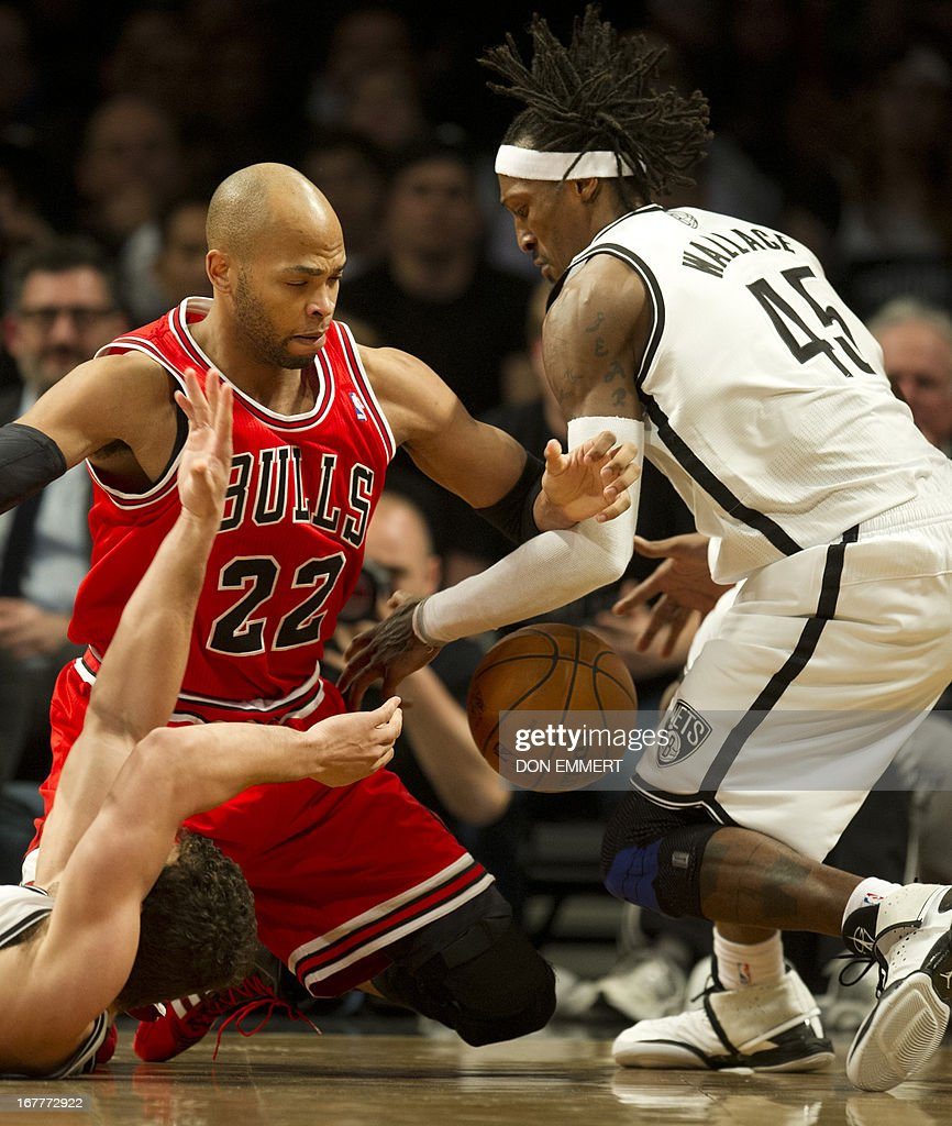 Chicago Bulls Taj Gibson (22) fights for the ball with Brooklyn Nets Gerald Wallace (45) during game five of their first round NBA playoff game April 29, 2013 at the Barclay Center in New York. AFP PHOTO/Don Emmert