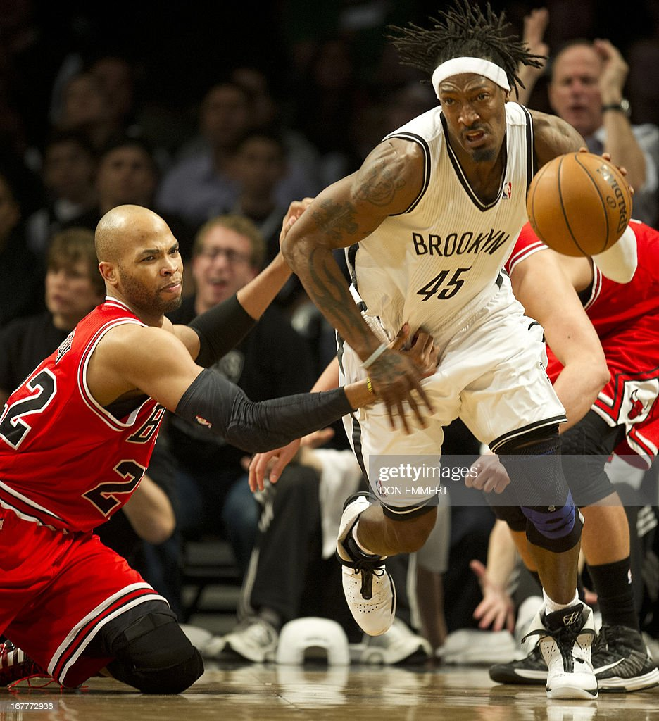Chicago Bulls Taj Gibson (22) loses the ball to Brooklyn Nets Gerald Wallace (45) during game five of their first round NBA playoff game April 29, 2013 at the Barclay Center in New York. AFP PHOTO/Don Emmert