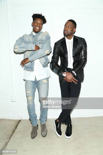 Chicago Bulls teammates Jimmy Butler and Dwyane Wade share a laugh while striking a pose backstage at Dwyane Wade's A Night on the Runwade Fashion...