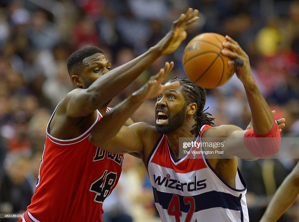 Chicago center Nazr Mohammed (48), defends Washington power forward Nene (42) going up for a shot as the Washington Wizards host the Chicago Bulls at the Verizon Center in Washington DC, January16, 2014.