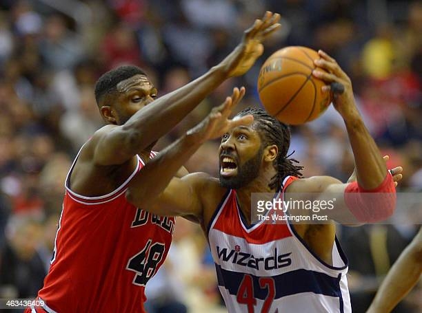 Chicago center Nazr Mohammed defends Washington power forward Nene going up for a shot as the Washington Wizards host the Chicago Bulls at the...