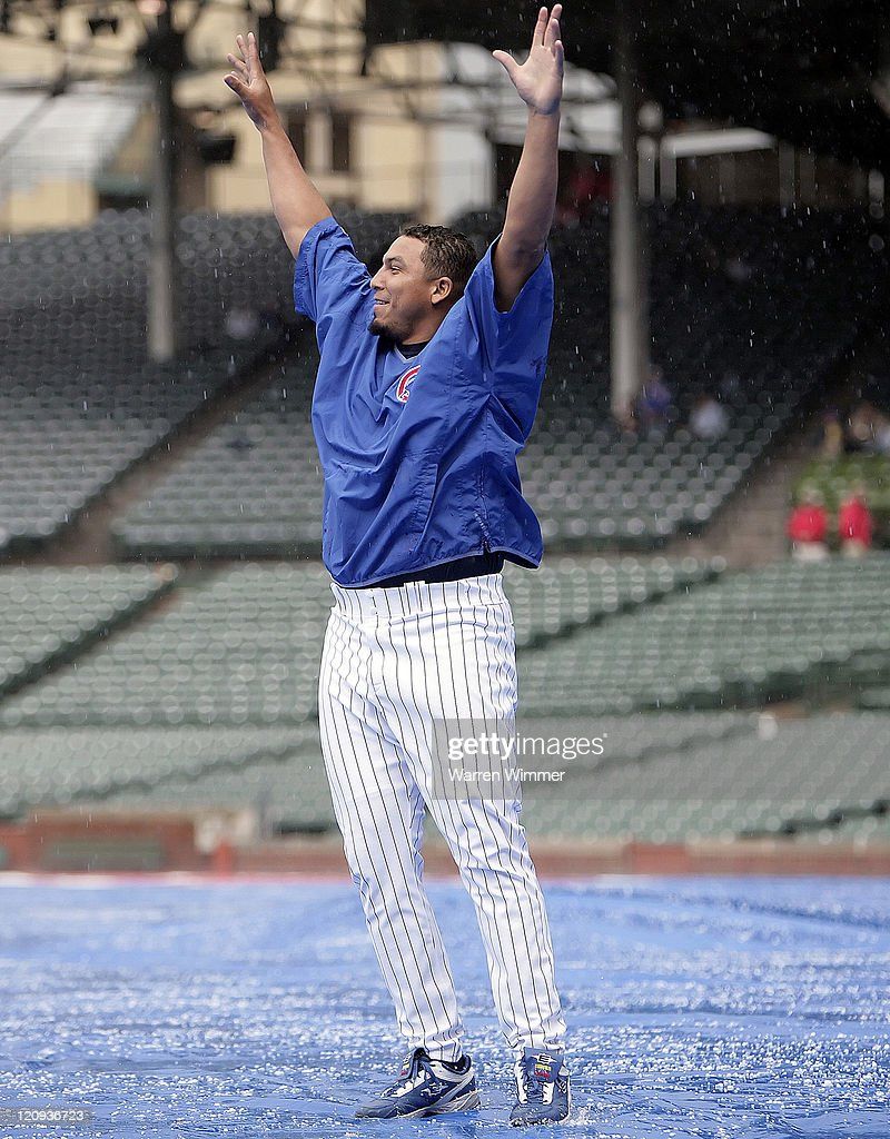 Chicago Cub pitcher, <a gi-track='captionPersonalityLinkClicked' href=/galleries/search?phrase=Carlos+Zambrano&family=editorial&specificpeople=203225 ng-click='$event.stopPropagation()'>Carlos Zambrano</a>, stands in a hail storm at the Washington Nationals vs Chicago Cubs game on May 17, 2006 at Wrigley Field.