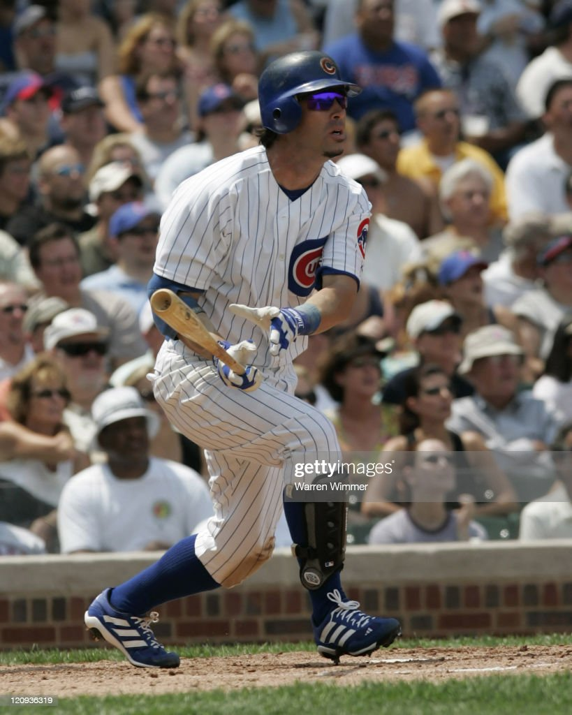 Chicago Cubs 2nd baseman Todd Walker homers in third inning off of Pittsburgs starter Mark Redman. Walkers home run ball got trapped in the right field basket above the ivy at Wrigley Field in Chicago, Illiinois on July 14, 2005. Chicago Cubs over the Pittsburg Pirates by a score of 5 to 1.
