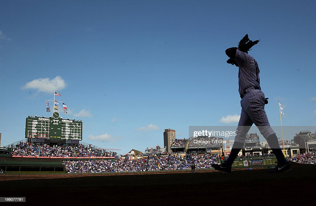 Chicago Cubs' Alfonso Soriano head out to left field during a MLB game against the Milwaukee Brewers at Wrigley Field in Chicago, Illinois, on Monday, April 8, 2013.