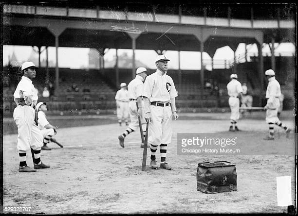 Chicago Cubs baseball player Johnny Evers standing among teammates at West Side Grounds Chicago Illinois 1908