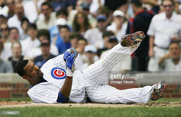 Chicago Cubs batter Derrek Lee goes down after being hit in the wrist by a pitch in the bottom of the fourth inning against the San Diego Padres...