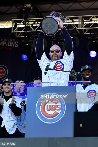 Chicago Cubs catcher David Ross lifts the commissioner trophy during the Chicago Cubs World Series victory rally on November 4 at Grant Park in...