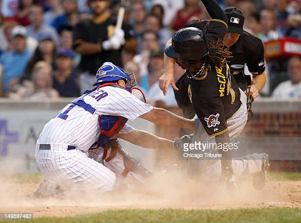 Chicago Cubs catcher Steve Clevenger left tags out the Pittsburgh Pirates' Andrew McCutchen during the third inning at Wrigley Field in Chicago...
