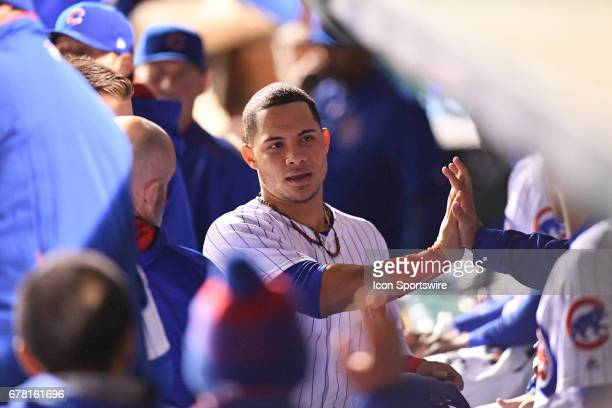 Chicago Cubs catcher Willson Contreras celebrates with teammates in the dugout after scoring in the sixth inning during a game between the...
