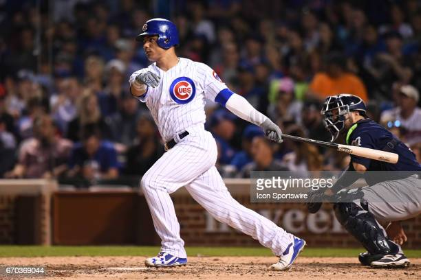 Chicago Cubs catcher Willson Contreras hits a single in the eighth inning during a game between the Milwaukee Brewers and the Chicago Cubs on April...
