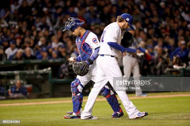 Chicago Cubs catcher Willson Contreras left and starting pitcher John Lackey in the fourth inning against the Los Angeles Dodgers in Game 5 of the...